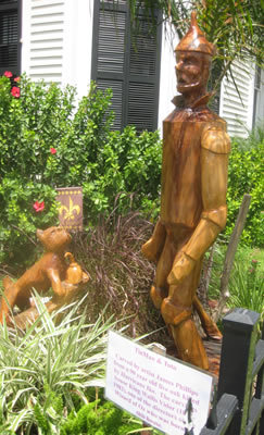 The Tin Man and Toto carved from salt damaged tree